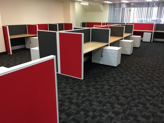 Office desks with fabric privacy screens and mobile caddy's in office space