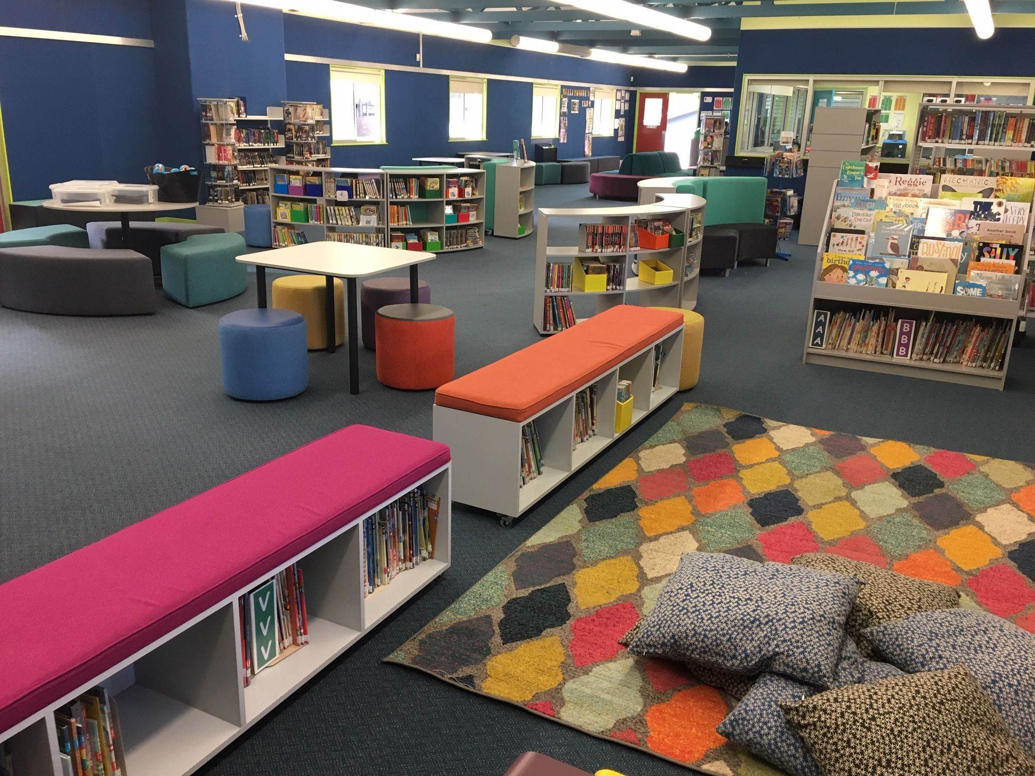 Primary school library with tables lounges and book cases