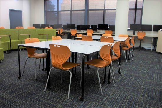 Ariah Chairs, kingstack tables, roundhouse and laptop tables in classroom