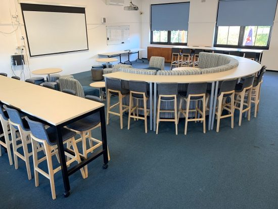 Bara Stools paired with Roundhouse bench and mobile bar leaner in classroom