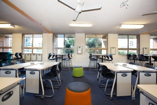 Ariah Chairs paired with teknik tables, mobile desks and round ottomans in classroom